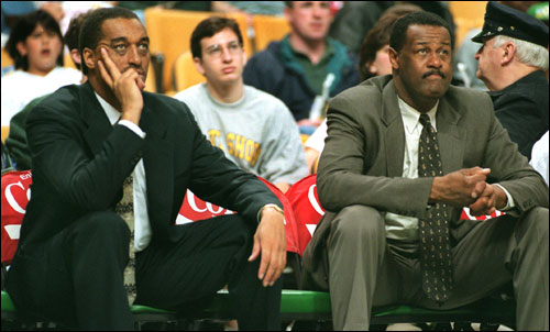 In this April 1997 photo, Johnson and Celtics head coach M.L. Carr watched yet another Boston effort wasted in a loss to the Bullets.