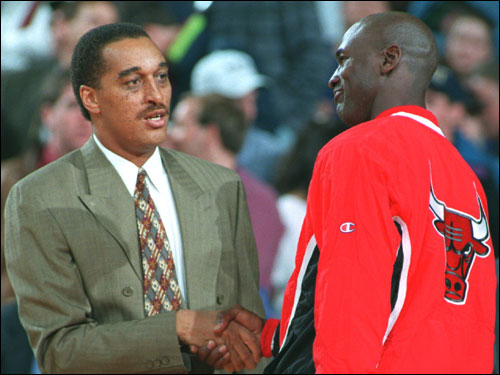The Bulls' Michael Jordan was greeted by Johnson in this March 1995 photo.