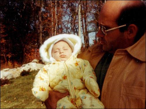 Henry Tameleo holding infant Gregory Tameleo.