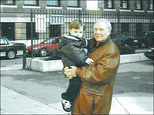 Salvati, holding his grandson, Michael, on Christmas Day in 1999 in the North End. Michael was born a month after his release from prison, while his eight other grandchildren were born when he was behind bars.