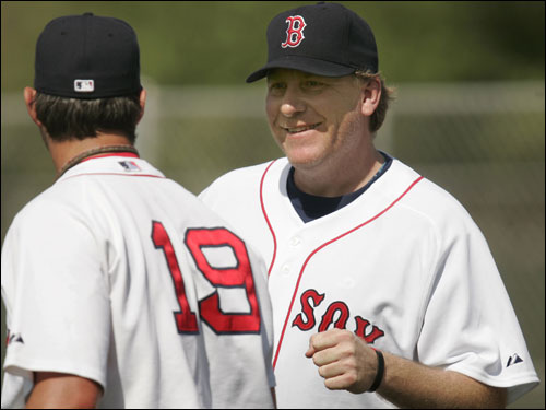 Red Sox pitcher Curt Schilling (right) greeted teammate Josh Beckett before taking to the mound.