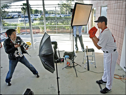 Here pitcher Daisuke Matsuzaka posed for a Japanese photographer outside the clubhouse, which was the final station for the players.