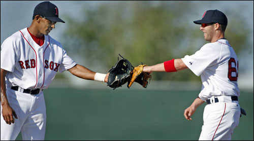 Red Sox second baseman Dustin Pedroia (right) and his new double play partner, shortstop Julio Lugo (left), were out by themselves, with no other infielders present, working on turning the double play early Saturday.