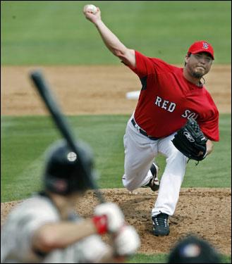 Josh Beckett fired a first-inning pitch vs. Northeastern University.