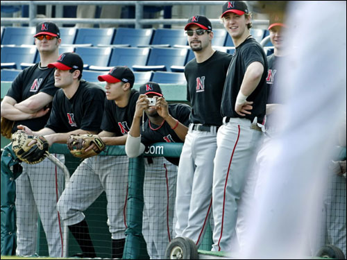 Members of the Huskies baseball team got an up-close view as the Red Sox went through infield drills on the field, one player even recorded the event with his camera.