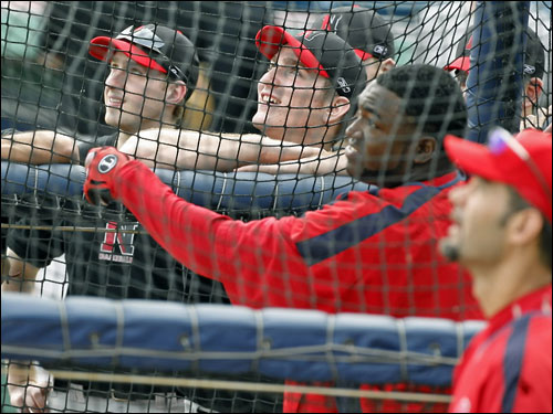 Members of the Huskies baseball team got a chance to get a close look as Sox slugger David Ortiz took batting practice.