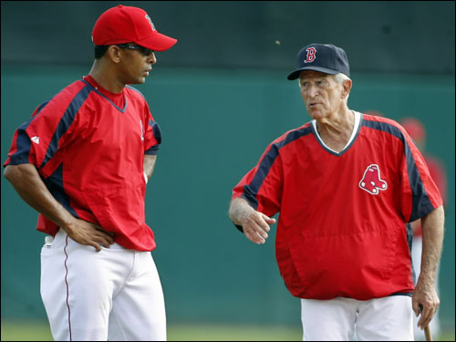 The Red Sox new shortstop Julio Lugo (left) listened as an old Red Sox shorstop, Johnny Pesky (right) imparted some advice during the morning workout.