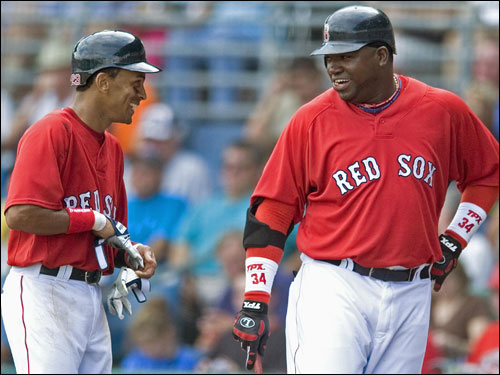 Julio Lugo (left) and David Ortiz talked near the on-deck circle.