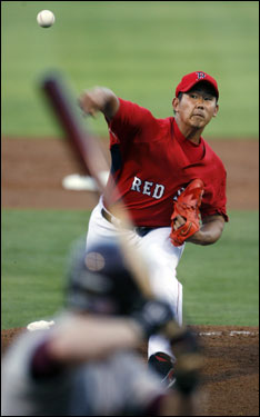 Matsuzaka delivered a pitch to home plate.