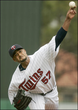 Twins pitcher Johan Santana delivered a throw against the Red Sox.