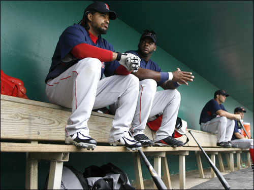 Manny Ramirez (left) sat with with teammate Wily Mo Pena in the Red Sox dugout.