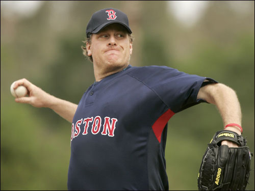 Curt Schilling warmed up before the start of the fourth inning.