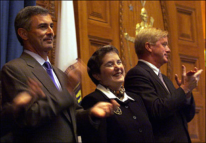 Former Governors Paul Celucci and William Weld applaud Martha Sosman during her swearing-in ceremony to be Associate Justice of the Supreme Judicial Court at the House Chambers in September of 2000.