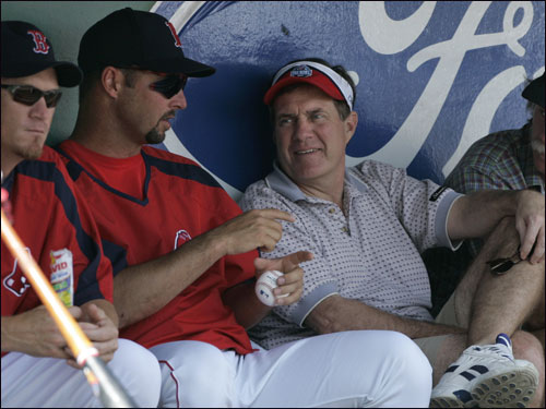 Patriots coach Bill Belichick (right) was in the Red Sox dugout to chat with Tim Wakefield and some of the Red Sox during Sunday's game against Baltimore.
