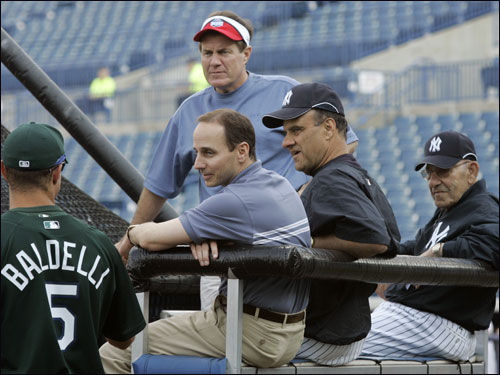 Tampa Bay Devil Rays outfielder Rocco Baldelli (left) greeted (left to right) Patriots head coach Bill Belichick, Yankees general manager Brian Cashman, Yankees manager Joe Torre, and Yankees special advisor Yogi Berra.