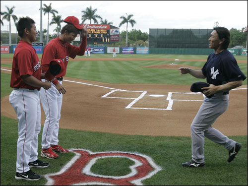 Red Sox pitchers Daisuke Matsuzaka (far left) and Hideki Okajima (left) shook hands with Yankees outfielder Hideki Matsui prior to the game.