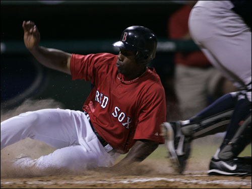Red Sox outfielder Alex Ochoa scored on a sacrifice by teammate Joe McEwing (not pictured) during the seventh inning.