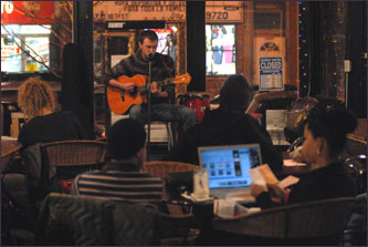 Andrew McManus, 19 performs during Wednesday open mike night at Cafe Mestizo on West 18th Street.