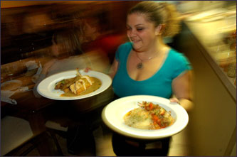 Waitress Jennifer Monterroso serves at Mundial Cocina Mestiza, a more upscale Mexican restaurant opened by husband and wife Eusevio and Katie Garcia in July 2006.