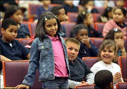 Brenda Tejada Baez received the Boston Public Schools 'Absolutely Incredible Kid' prize at the Louis Agassiz Elementary School yesterday.