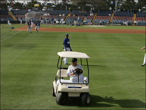 Tommy Lasorda passed through the outfield of Holman Stadium in his golf cart during batting practice before a spring training game against the Boston Red Sox.