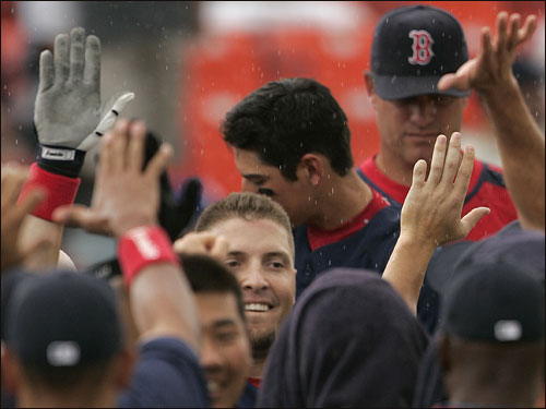 Eric Hinske (center) was congratulated by teammates after hitting a three-run home run to put the Red Sox up 5-1.