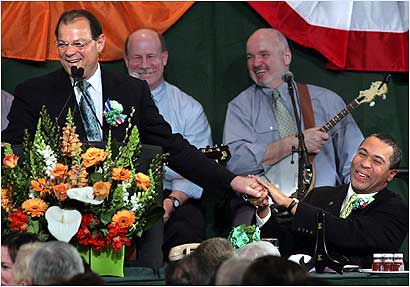 Fellow politicians took aim at Governor Deval Patrick yesterday at the annual St. Patrick's Day breakfast in South Boston. Senate President Robert E. Travaglini (left) said the governor took the ribbing 'like a trouper.'