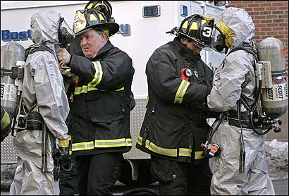 Firefighters donned protective suits to investigate smoke inside a Boston U