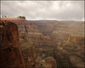 People took the first official walk on the Skywalk, billed as the first-ever cantilever-shaped glass walkway extending 70 feet from the western Grand Canyon's rim more than 4,000 feet above the Colorado River, on March 20 on the Hualapai Reservation in Arizona.