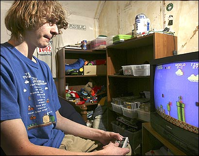17 year-old Andrew Gardikis, a Super Mario Bros. champ, plays the video game in his room in Quincy.