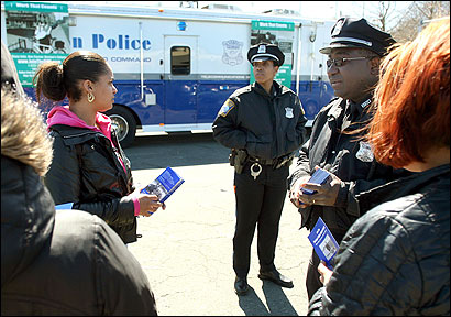 On a recruitment drive yesterday in Dorchester were Boston police officers Atiya Younger (left rear) and Hubert Valmond.