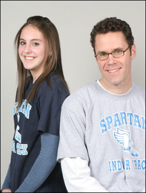 Girls' track Runner of the Year Christina Izzicupo, left, of Stoneham poses with her coach and the Globe's Division 3 Coach of the Year, Kevin Norton.