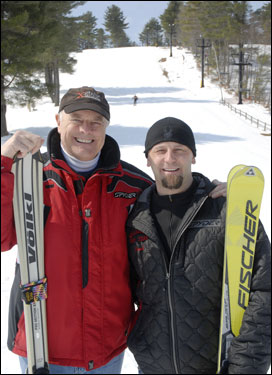 With Nashoba Valley Ski Area in the background, Concord-Carlisle's Bob Furey and Wellesley's Scott Mighill smile after being named Coaches of the Year.