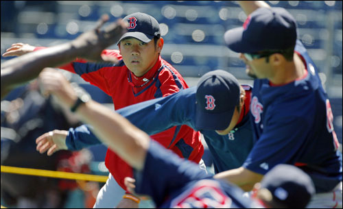 Red Sox rookie pitcher Daisuke Matsuzaka loosened up with his teammates prior to Boston's batting practice.