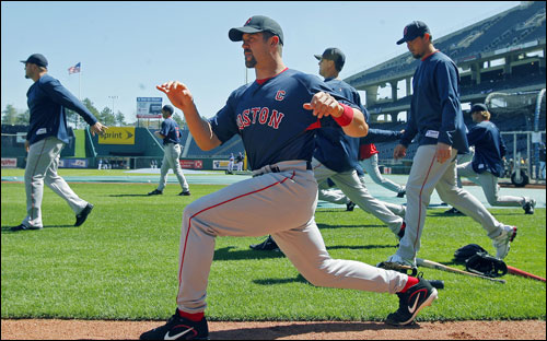 Red Sox captain Jason Varitek loosened up with his teammates prior to Boston's batting practice.
