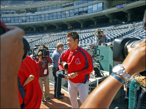 As usual, Red Sox rookie pitcher Daisuke Matsuzaka was the center of attention as he came out of the dugout.