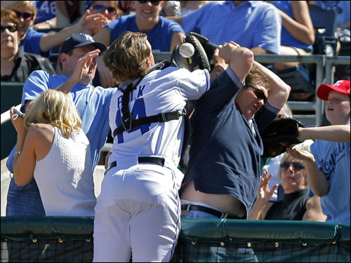 A fan appeared to interfere with Royals catcher John Buck on a foul ball in the first inning.