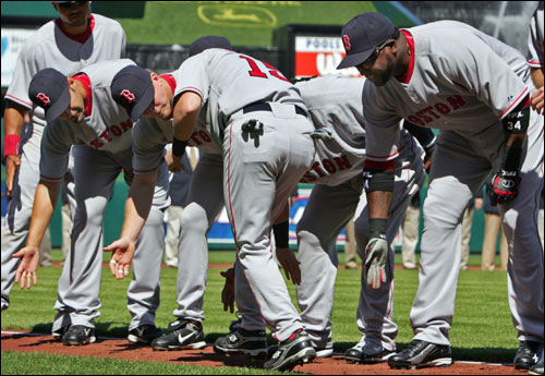 Red Sox players gave low-fives to their teammates being introduced before the game.