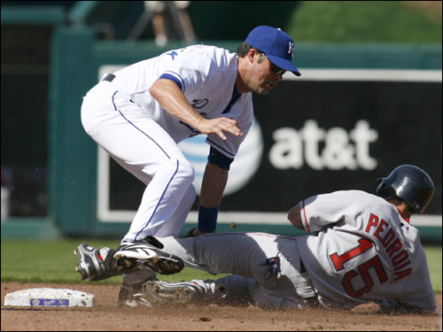 Dustin Pedroia (15) was tagged out by Royals second baseman Mark Grudzielanek as he tried to stretch a single in the second inning.