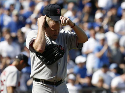 Curt Schilling reacted to giving up a run in the second inning.