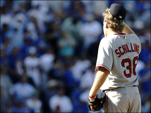 Curt Schilling removed his hat after giving up three runs in the fourth inning.