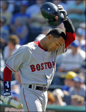 Julio Lugo reacted after striking out in his first at bat in a Red Sox uniform.