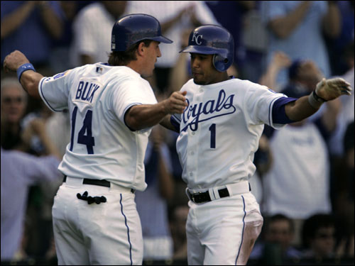 Royals John Buck (left) and Tony Pena, Jr. celebrated after scoring in the fourth inning.