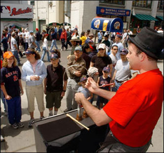 Fans line up on Yawkey Way to enjoy some of the entertainment. Magic man Matthew Graham of Medford performs as part of the Yawkey Way pregame festivities.