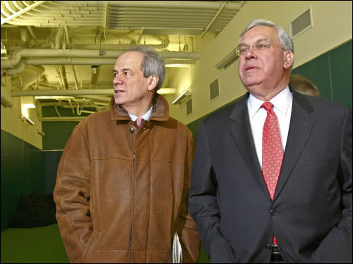 Larry Lucchino (left) and Boston mayor Thomas Menino toured the new, indoor batting area at Fenway Park on Wednesday.