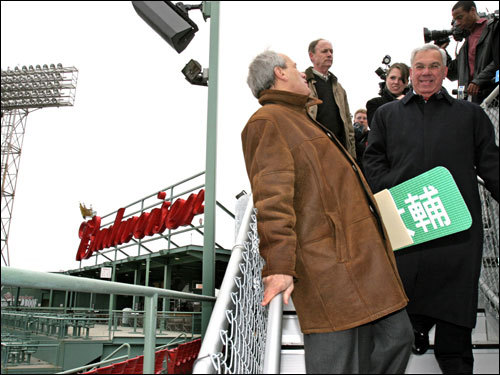 Larry Lucchino (left) and Boston mayor Thomas Menino toured 'Conigliaro's Corner,'' new affordable roof top seats at Fenway Park.