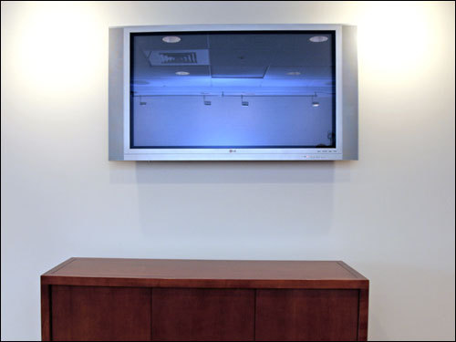 A new private suite at Fenway Park has a flat panel television.