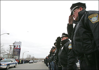 Police officers lined the street yesterday at the Moakley Courthouse in South Boston before the resentencing of a man convicted of killing one officer and injuring another with a bomb in 1991.
