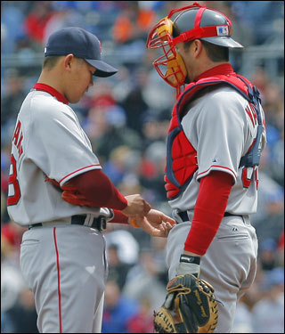 Varitek came out to the mound to tell Matsuzaka that the umpire wanted the pitcher to remove some kind of wrist band he had on.