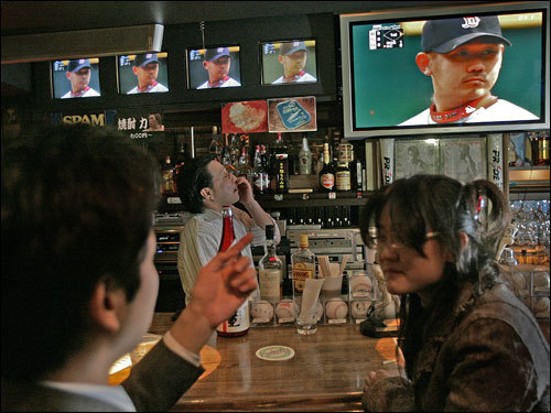 At the BRAIN BUSTER sports bar in Tokyo, Japanese baseball fans including bartender Kyozo Watanabe (center) watched Red Sox pitcher Daisuke Matsuzaka pitch against Kansas City.